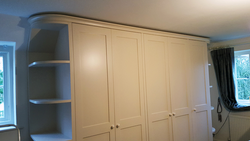curved wardrobe by Mark Williamson Furniture