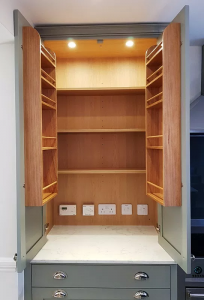 Larder cupboard with built in sockets